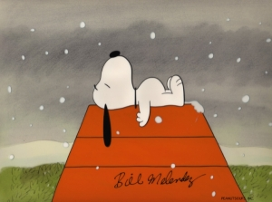 Snoopy laying on Dog House
